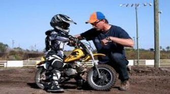kid riding motorcycle