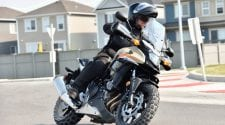2016 Honda CB500X turning in a traffic circle.