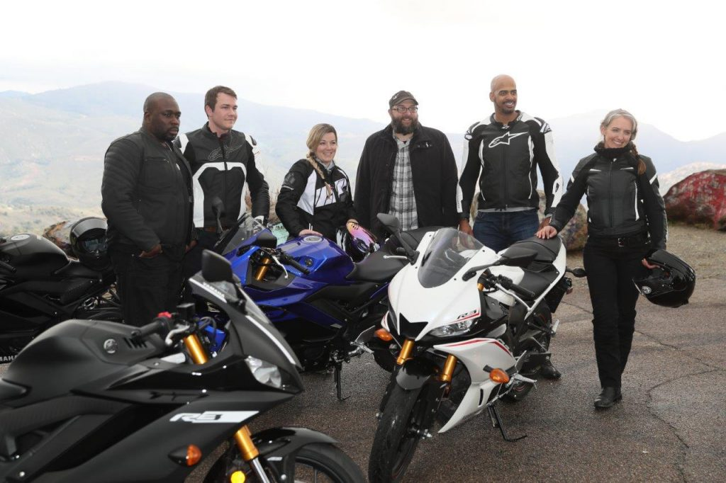 Group photo of team with the new 2019 Yamaha YZF-R3 in all model colors