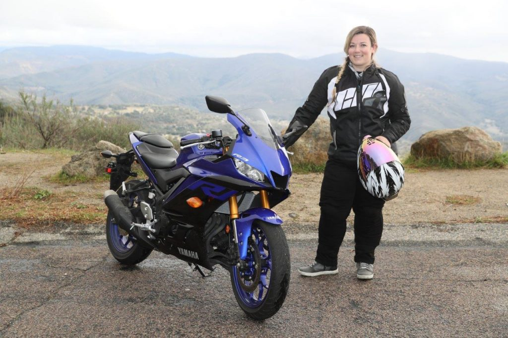 Brittany Morrow posing with the 2019 Yamaha YZF-R3