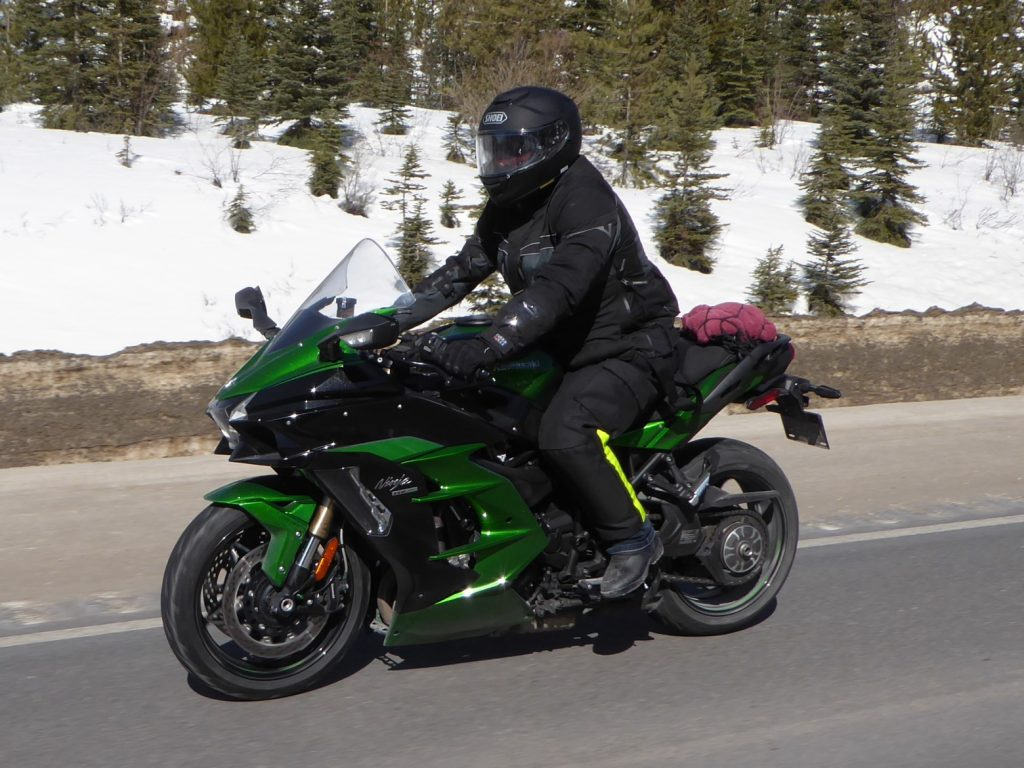 Me riding while wearing the Shoei GT Air helmet.