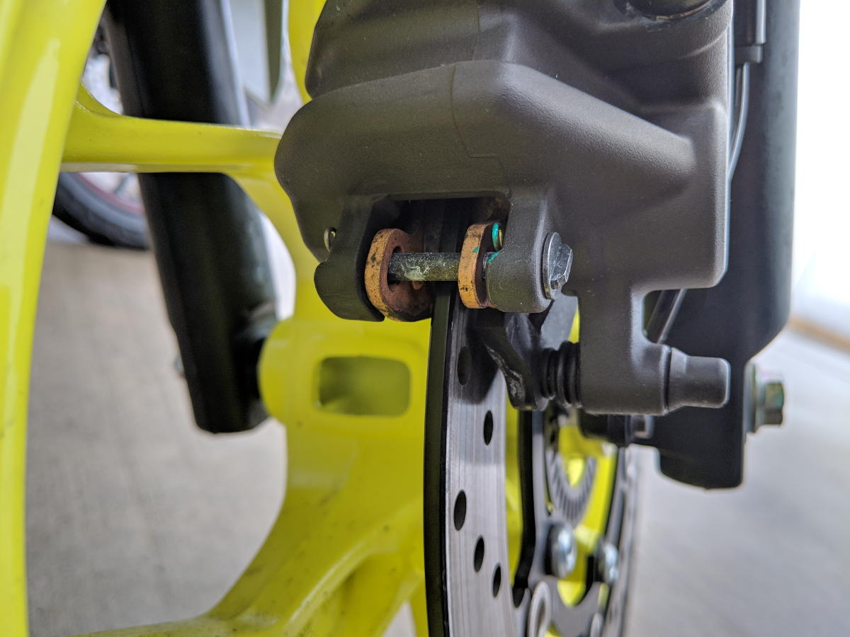 Close up of a motorcycle disc brake caliper