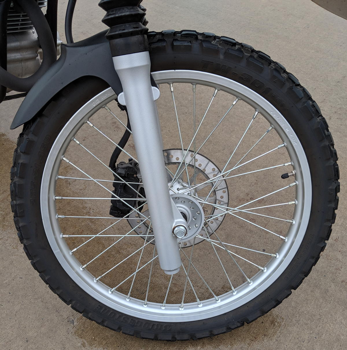 A spoked/sprocket motorcycle rim